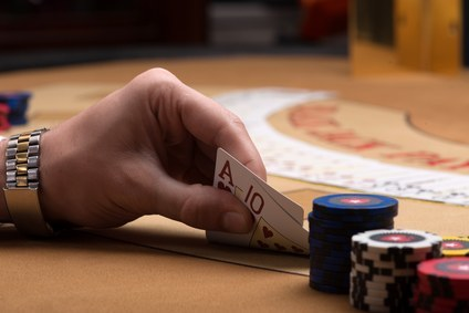 professional poker player reviewing their card hand