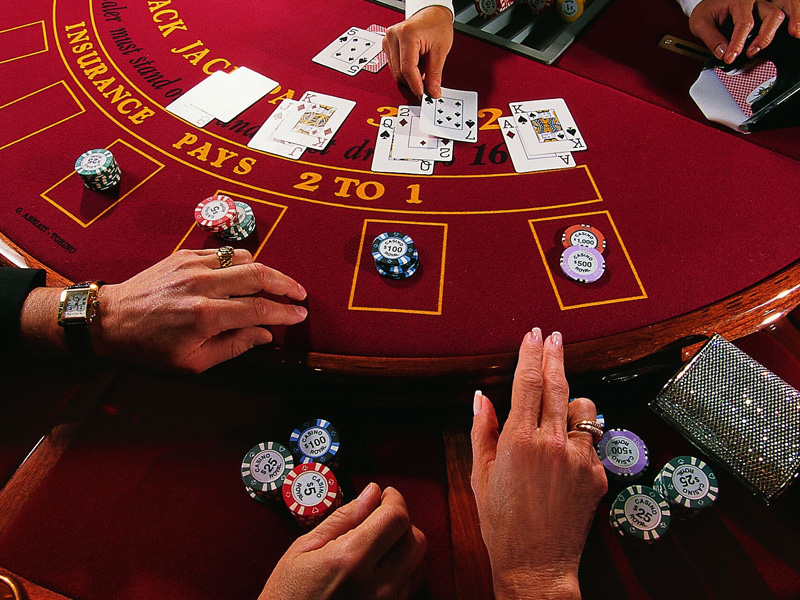 hands playing at blackjack table