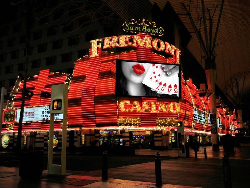 empty cinema auditorium with poker advertisement on the screen