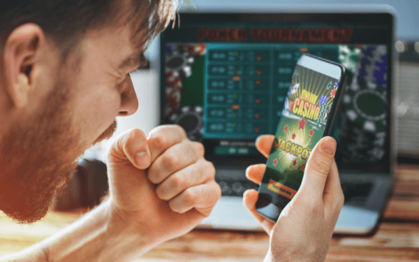man playing at an online casino on his phone